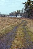 Road through the field to a white house Stock Photography
