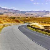 Road between Fields Stock Image