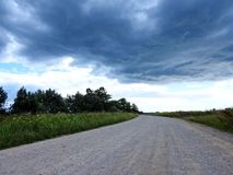 Road , fields and beautiful cloudy sky, Lithuania Stock Photos