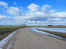 Road and fields in flood, Lithuania royalty free stock image