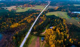 Road through fields and forest, aerial. Photo near Moletai Royalty Free Stock Photos