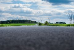 Road through the fields. Road through the green fields Royalty Free Stock Photo