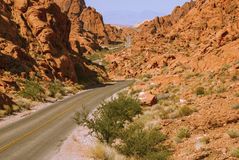The road through the fiery rocks. Valley of Fire State Park, Nevada, USA Stock Images