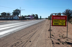 Road fire safety sign on highway in outback Stock Photography