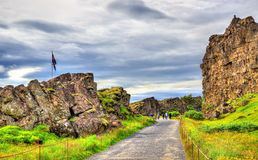 Road in a fissure between tectonic plates in the Thingvellir National Park - Iceland Royalty Free Stock Images