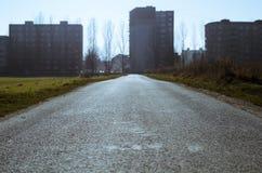 Road and flats. On horizon Royalty Free Stock Photos
