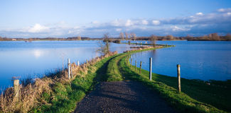 Road into a flooded river Royalty Free Stock Images