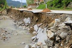 Road after flooding. Part of Road Landslide Erosion After Floods Royalty Free Stock Photo