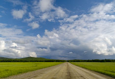 Road in floors under cloudy sky Stock Photo