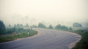 Road in the fog Royalty Free Stock Photo