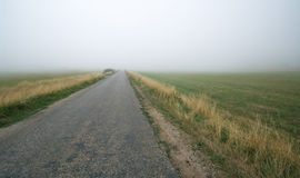 Road in fog Royalty Free Stock Image