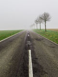 Road in fog leads to nothing Stock Image