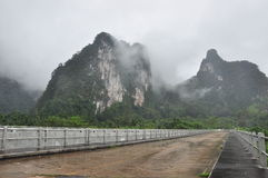 Road fog in the morning time. The Road fog in the morning time in Thailand Stock Photos