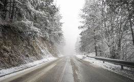 Road in the fog. Mysterious Way. Snowy mountain road. Risk of ic Royalty Free Stock Image