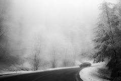 Road in the fog. Mysterious Way. Snowy mountain road. Risk of ic Stock Photo