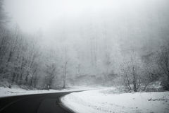 Road in the fog. Mysterious Way. Snowy mountain road. Risk of ic Royalty Free Stock Images