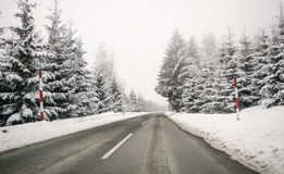 Road in the fog. Mysterious Way. Snowy mountain road. Risk of ic Royalty Free Stock Photos