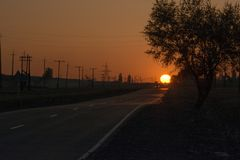 The road in the fog. Sunset. The sun. royalty free stock photography