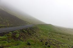 Road in the fog. Thick fog and empty road stock photo