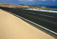 Road follow the atlantic coast. Asphalt road follow the atlantic coast Stock Photos