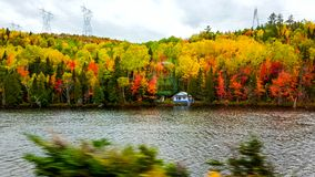 On the road, Font of the lake, autumn colors, Tadoussac Quebec Royalty Free Stock Images
