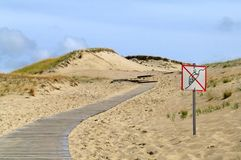 Road with forbidden area in dunes Royalty Free Stock Photos