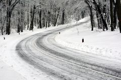 Road in the forefront ,which turns the ice forest royalty free stock image