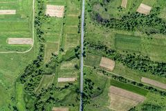 Road and forest aerial view. Drone photo. Road and forest aerial view. Picture taken with a drone stock image