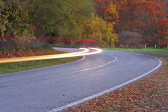 Road in forest.Car lights in Navarre. Spain Royalty Free Stock Photos