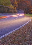 Road in forest.Car lights in Navarre. Spain Royalty Free Stock Image