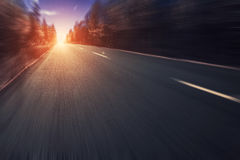 Road in forest with motion blur Stock Photo