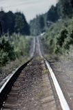 Road through forest. - railway is lost in haze. Summer day, railage. Single-track railroad Stock Photo