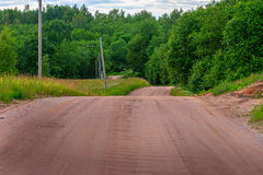 Road in forest. Forest road that ran through the green trees Royalty Free Stock Images