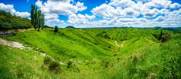 On the road, forgotten world highway, new zealand 9. Green hills, lush grass, blue sky with white clouds. on the road, forgotten world highway, new zealand stock images