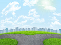Road fork, green grass field and city. Sky with Stock Photography