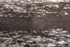 Road frazil with salt. Frost after thaw. Desc royalty free stock photo