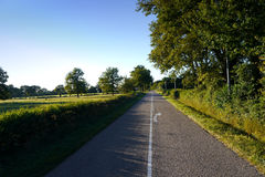 Road through french countryside. Empty road in the country Stock Photography