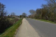 Road. French road, illuminated bright sun Royalty Free Stock Photography