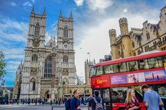 Road in front of Westminster Abbey full of cars, buses and tourists in the city of Westminster, London, UK royalty free stock photography