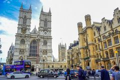 Road in front of Westminster Abbey full of cars, buses and tourists in the city of Westminster, London, UK stock photo