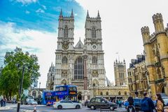 Road in front of Westminster Abbey full of cars, buses and tourists in the city of Westminster, London, UK royalty free stock photo