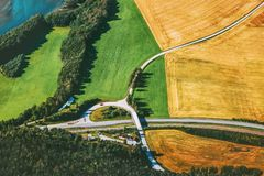 Road and geometric fields aerial view rural Landscape. In Norway nature ecology concept Stock Images