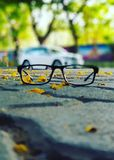 Glasses on road Stock Photo