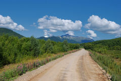 Road going into the distance. To mountain Royalty Free Stock Images