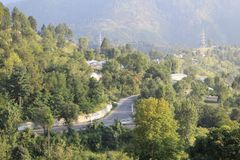 Road going through the Himalayas mountain. One view of the Himalayas mountains from the top in the sub continent countries in Mansehra`s region Stock Image