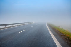 Road going in to the fog Royalty Free Stock Images