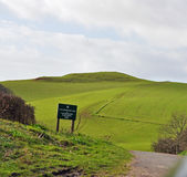 Road going towards a hill. Road in the countryside going down towards a hill Stock Photos