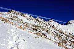 Road going up the mountains through deep snow in Retezat mountains, Romania Royalty Free Stock Photo