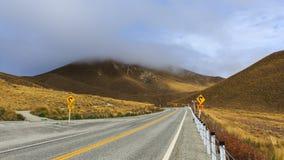 Road through the golden alpine Stock Photo
