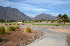 The road between the golf courses. Egypt, the road between the golf courses in the resort area mountains in the background and blue sky Stock Photo